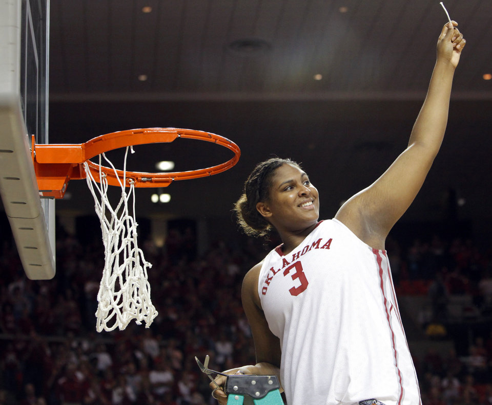 Photo - OU's Courtney Paris holds up a piece of the net to celebrate the Sooners regular season Big 12 championship after the women's college basketball game between Texas Tech and Oklahoma at the Lloyd Noble Center in Norman, Okla., Wednesday, March 4, 2009. OU beat Texas Tech, 61-49. BY NATE BILLINGS, THE OKLAHOMAN