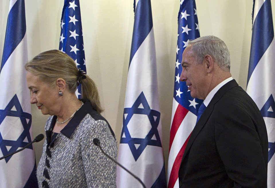 "Israel's Prime Minister Benjamin Netanyahu, right, and U.S. Secretary of State Hillary Rodham Clinton leave after delivering joint statements in Jerusalem, Tuesday, Nov. 20, 2012. A diplomatic push to end Israel's nearly weeklong offensive in the Gaza Strip gained momentum Tuesday, with Egypt's president predicting that airstrikes would soon end, the U.S. secretary of state racing to the region and Israel's prime minister saying his country would be a ""willing partner"" to a cease-fire with the Islamic militant group Hamas.(AP Photo/Baz Ratner, Pool)"