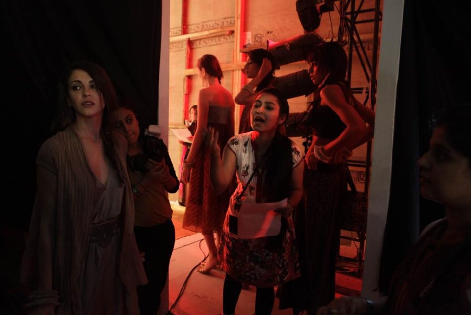 Photo -  A model coordinator asks models to line up before a show during the Wills Life Style India Fashion Week, in New Delhi, India, Thursday, April 7, 2011.  (AP Photo/Manish Swarup) ORG XMIT: DEL142