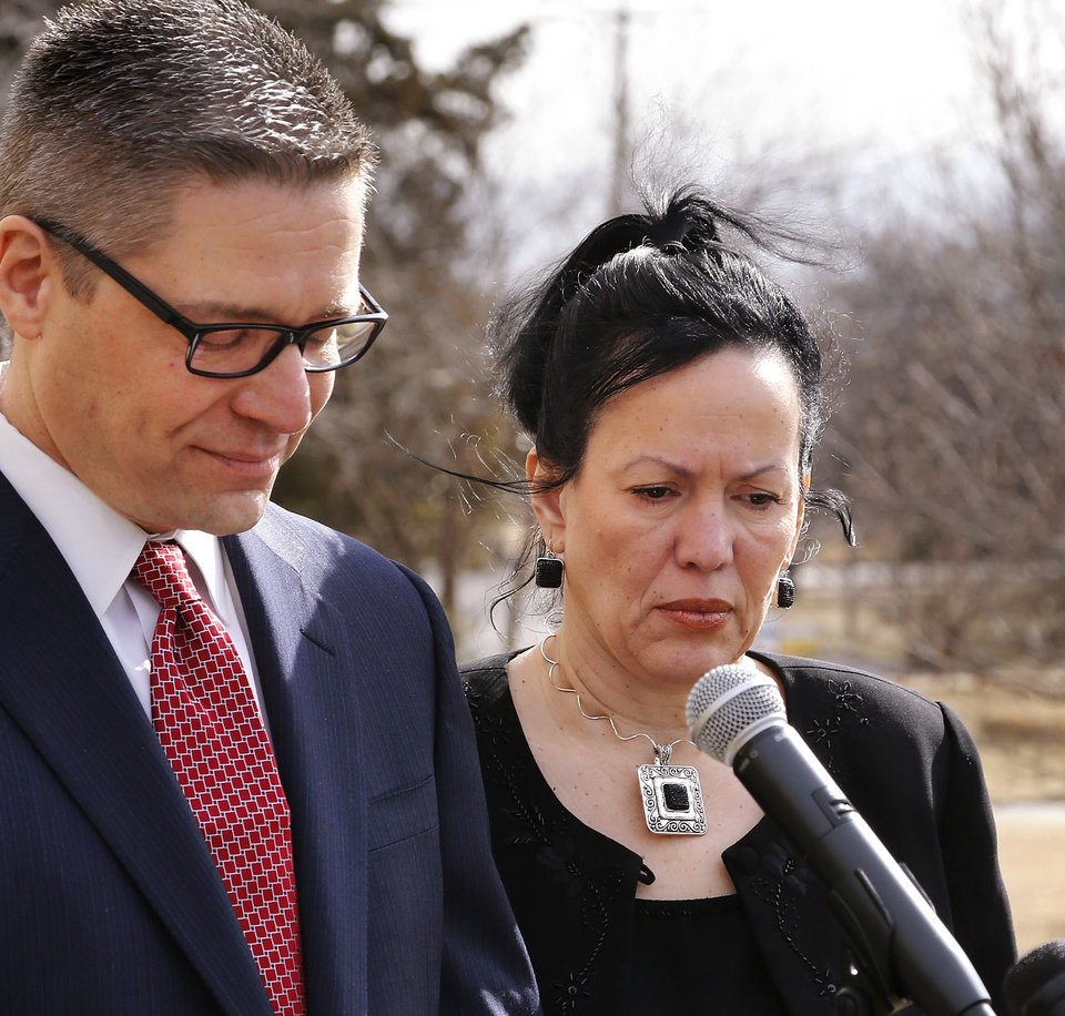 Photo - Attorney Michael Brooks-JimÂŽnez walks to microphones, accompanied by Nair Rodriguez, where he reads a statement before releasing the cell phone video taken on Feb. 15  in the parking lot of a Moore movie theatre where Luis Rodriguez  died after being handcuffed by police officers.  The  video was recorded by Rodriguez's wife, Nair.  The news conference was held in front of Northwest Free Will Baptist Church, 4625 NW 36 on Tuesday morning, Feb. 25, 2014.     Photo by Jim Beckel, The Oklahoman