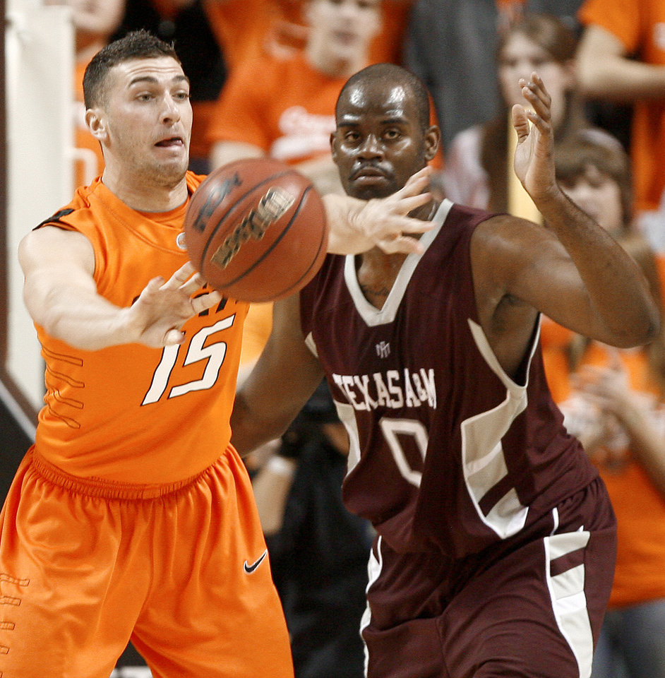 Photo - OSU's Nick Sidorakis passes the ball beside Texas A&M's Bryan Davis during an NCAA college basketball game between the Oklahoma State University and Texas A&M at Gallagher-Iba Arena in Stillwater, Okla., Wednesday, January 27, 2010. Photo by Bryan Terry, The Oklahoman