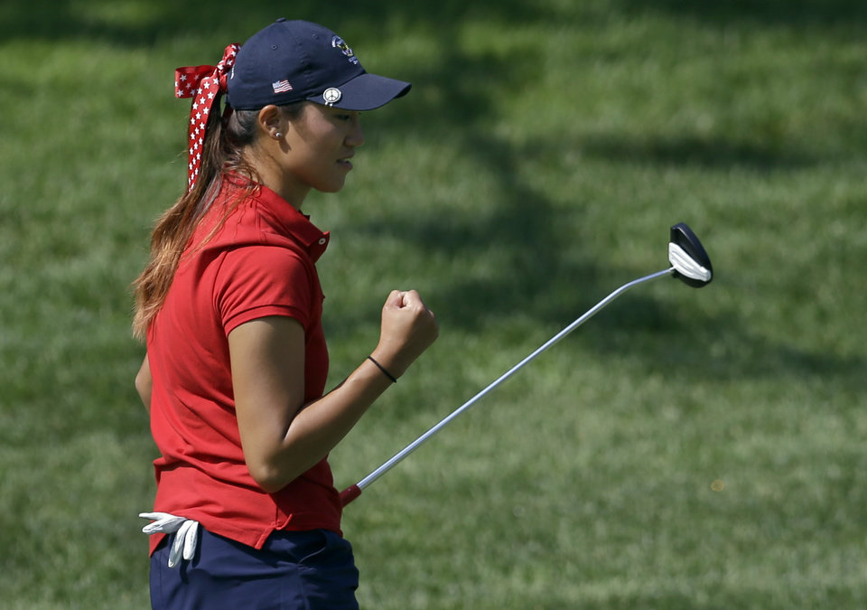 Photo - United States' Annie Park celebrates after putting in on the fifth hole during the 38th Curtis Cup amateur golf match against Great Britain and Ireland Friday, June 6, 2014, in St. Louis. (AP Photo/Jeff Roberson)