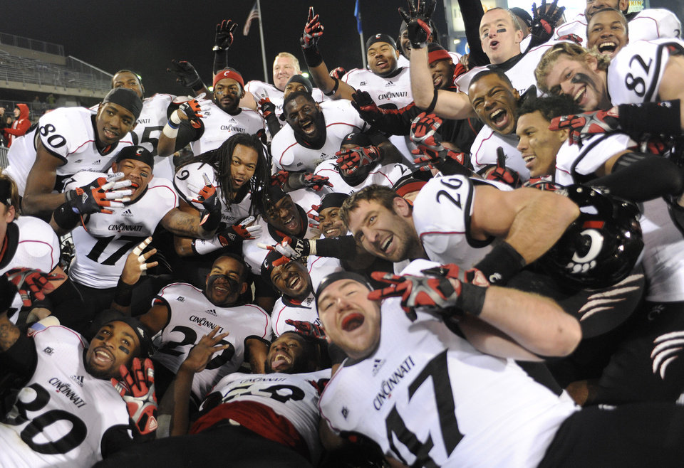 Photo - Cincinnati celebrates their Big East Championship at the end of an NCAA college football game against Connecticut at Rentschler Field in East Hartford, Conn., Saturday, Dec. 1, 2012. Cincinnati is sharing the title along with Rutgers, Syracuse and Louisville.  Cincinnati defeated Connecticut 34-17. (AP Photo/Jessica Hill)