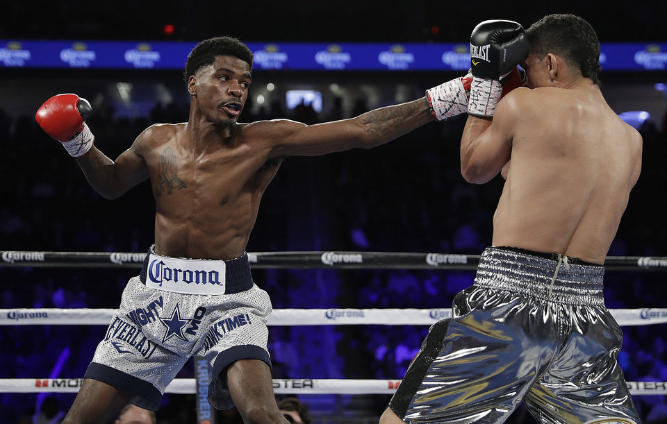 Photo -  Maurice Hooker, left, will defend his WBO lightweight world title Friday against Alex Saucedo. [AP PHOTO]