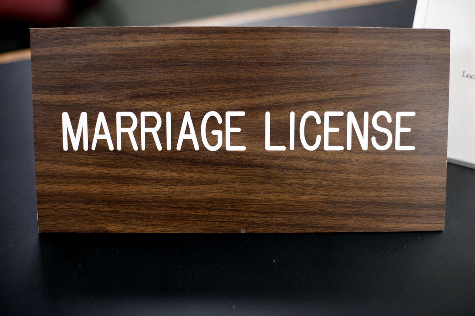 "A placard on a desk reading ""marriage license"" is at a Montgomery County office, Wednesday, July 24, 2013, in Norristown, Pa. Two women have been married in a religious ceremony Wednesday near Philadelphia after getting a same-sex license from Montgomery County officials defying a state ban. (AP Photo/Matt Rourke)"