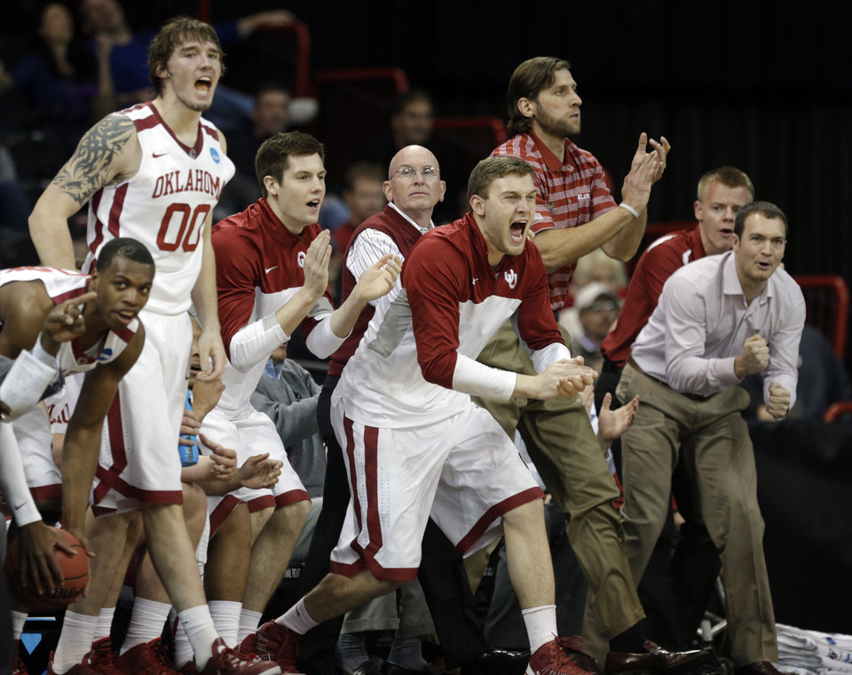 Photo - The Oklahoma bench cheers on the Sooners during the NCAA men's basketball tournament game between the University of Oklahoma and North Dakota State at the Spokane Arena in Spokane, Wash., Thursday, March 20, 2014. Photo by Sarah Phipps, The Oklahoman