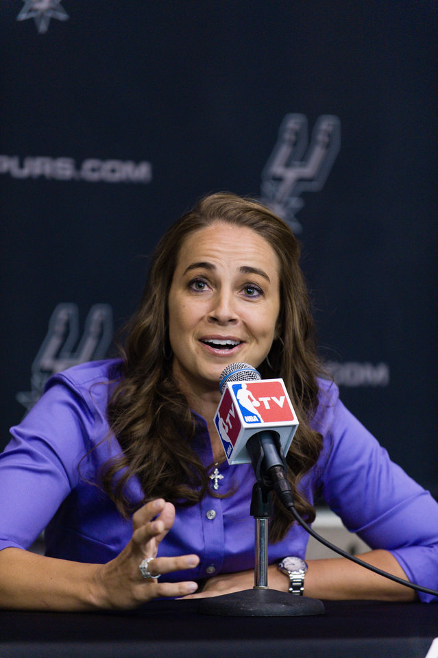 Photo - WNBA star Becky Hammon takes questions from the media at the San Antonio Spurs practice facility after being introduced as an assistant coach with the team on Tuesday, Aug. 5, 2014 in San Antonio. The San Antonio Spurs hired WNBA star Becky Hammon on Tuesday, making her the first full-time, paid female assistant on an NBA coaching staff.  (AP Photo/Bahram Mark Sobhani)