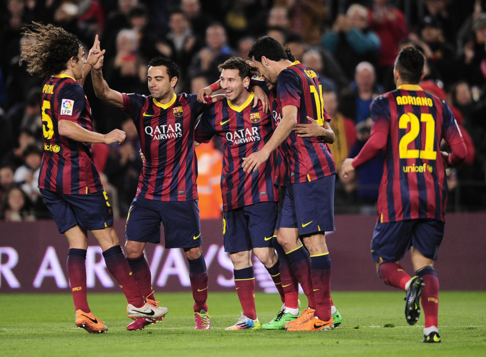 Photo - FC Barcelona's Lionel Messi, from Argentina, center, reacts after scoring with his teammates against Almeria during a Spanish La Liga soccer match at the Camp Nou stadium in Barcelona, Spain, Sunday, March 2, 2014. (AP Photo/Manu Fernandez)