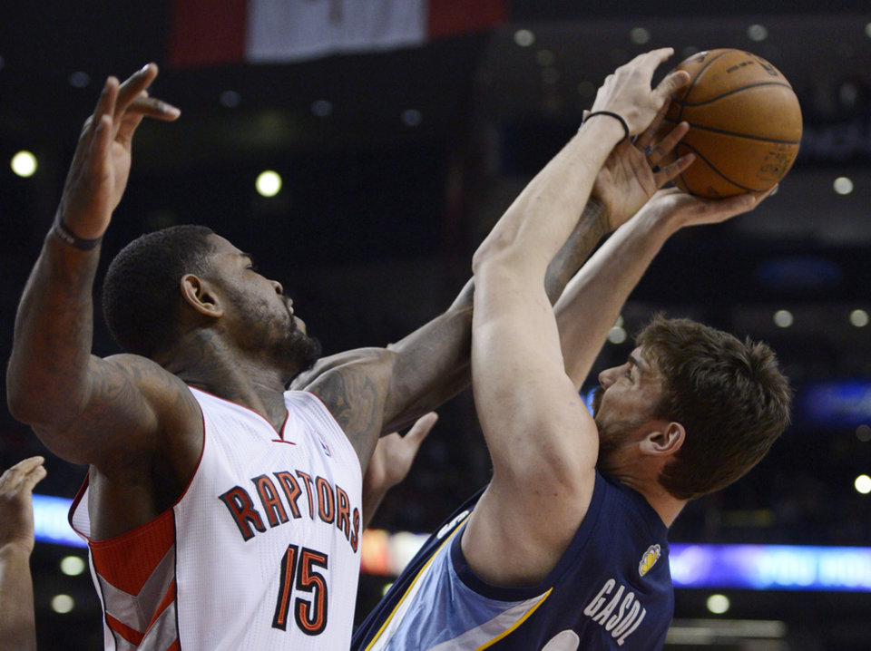 Toronto Raptors' Amir Johnson defends Memphis Grizzlies center Marc Gasol during the first half of an NBA basketball game in Toronto on Wednesday, Feb. 20, 2013. (AP Photo/The Canadian Press, Frank Gunn)