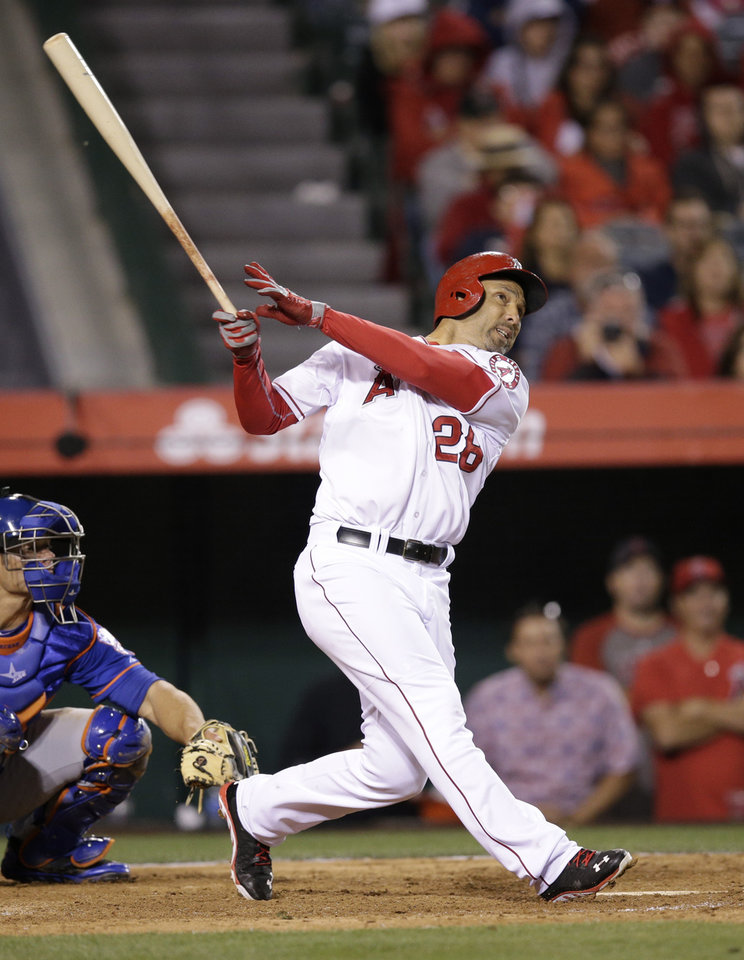 Photo - Los Angeles Angels' Raul Ibanez watches his three-run home run during the ninth inning of a baseball game against the New York Mets on Saturday, April 12, 2014, in Anaheim, Calif. (AP Photo/Jae C. Hong)