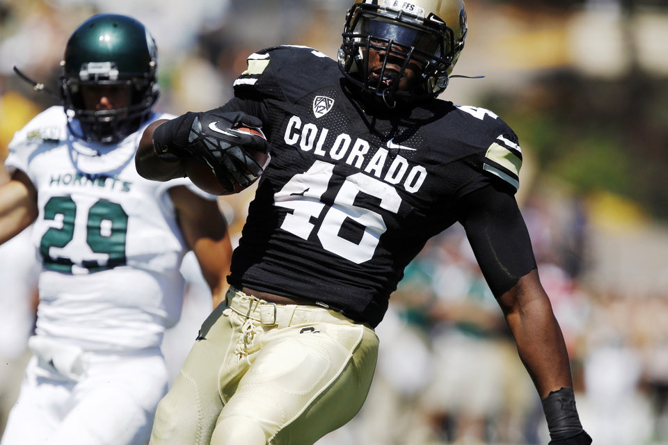 Photo -   Colorado fullback Christian Powell celebrates as he scores a touchdown on a run past Sacramento State defensive back Robert Beale in the first quarter of an NCAA college football game in Boulder, Colo., Saturday, Sept. 8, 2012. (AP Photo/David Zalubowski)