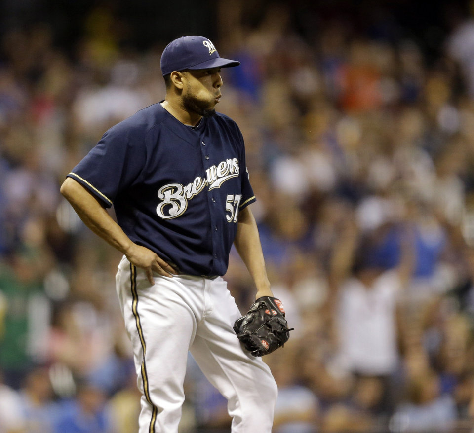 Photo - Milwaukee Brewers' Francisco Rodriguez watches as New York Mets' Lucas Duda rounds the bases after his two-run home run against the Milwaukee Brewers during the ninth inning of a baseball game Friday, July 25, 2014, in Milwaukee. (AP Photo/Jeffrey Phelps)