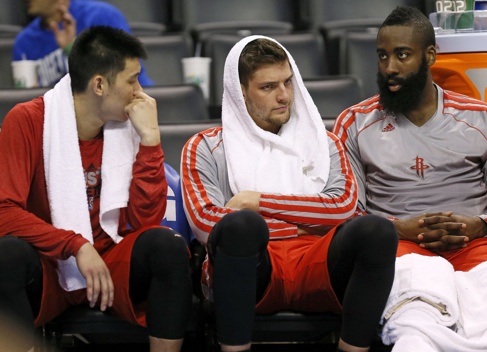 Photo - From left, Houston's Jeremy Lin (7), Chandler Parsons (25) and James Harden (13) sit on the bench in the fourth quarter during Game 1 in the first round of the NBA playoffs between the Oklahoma City Thunder and the Houston Rockets at Chesapeake Energy Arena in Oklahoma City, Sunday, April 21, 2013. Oklahoma City won, 120-91. Photo by Nate Billings, The Oklahoman