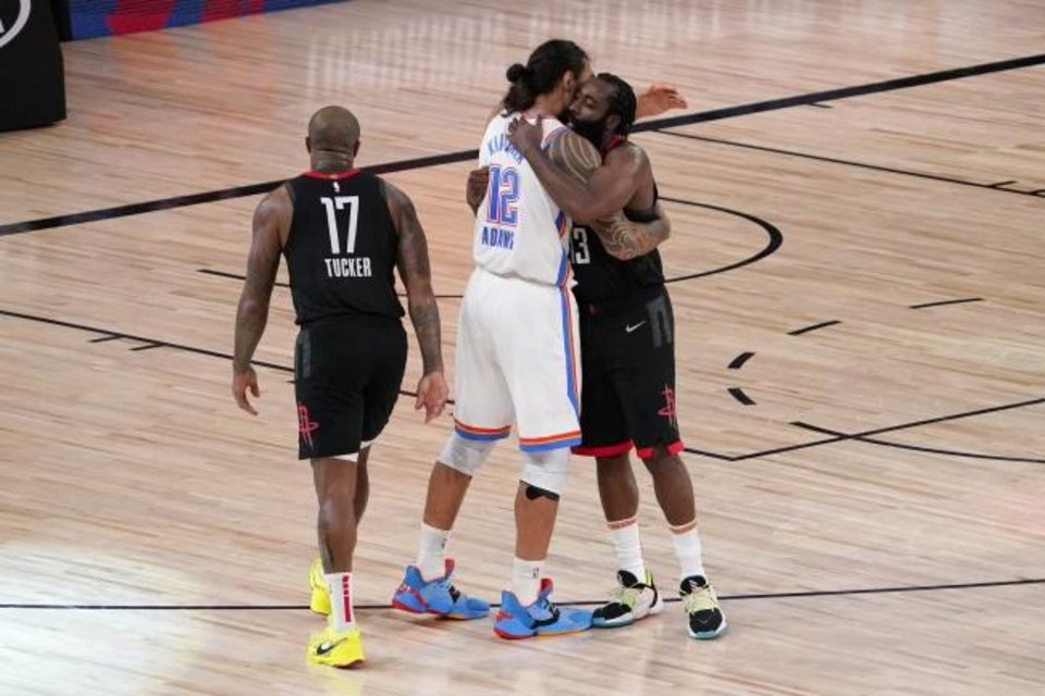 Photo -  Houston Rockets' P.J. Tucker (17) and James Harden, right, greet Oklahoma City Thunder's Steven Adams (12) after their NBA first-round playoff basketball game in Lake Buena Vista, Fla., Wednesday, Sept. 2, 2020. (AP Photo/Mark J. Terrill)