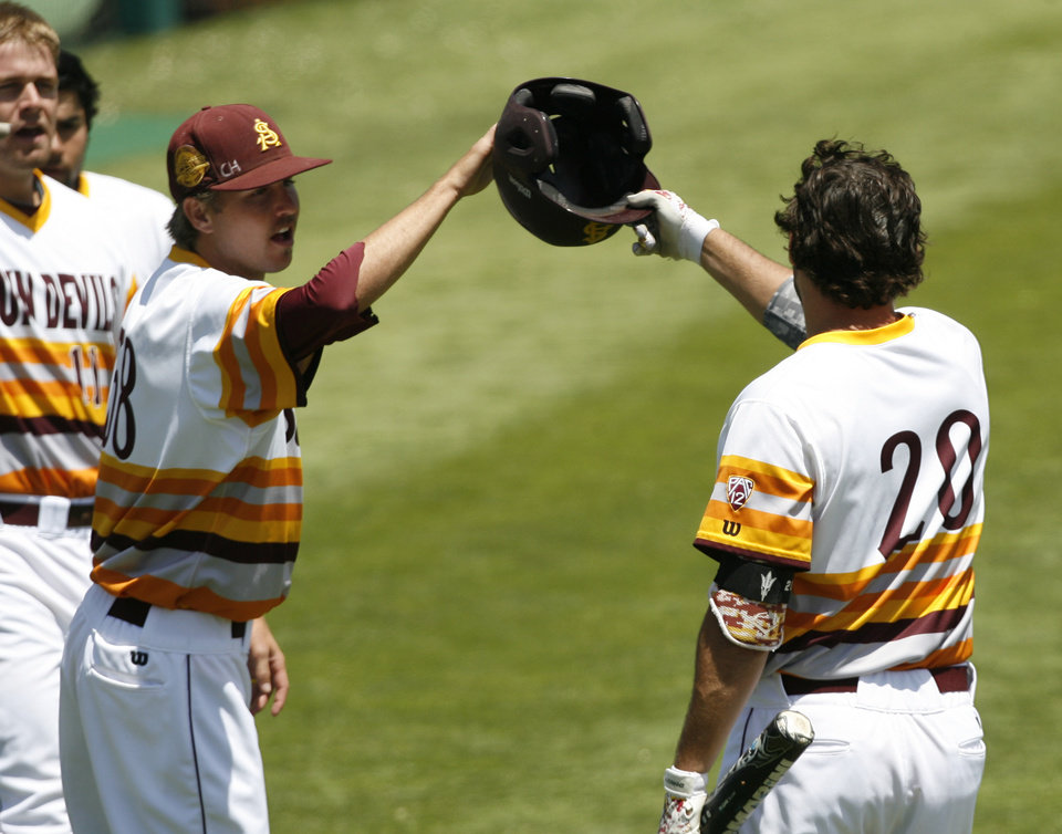 Photo - Arizona State's Trever Allen (20) is congratulated by Josh McAlister (58) after hitting a home run in the second inning against Pepperdine in an NCAA college baseball tournament regional game Friday, May 30, 2014, in San Luis Obispo, Calif. (AP Photo/Aaron Lambert)