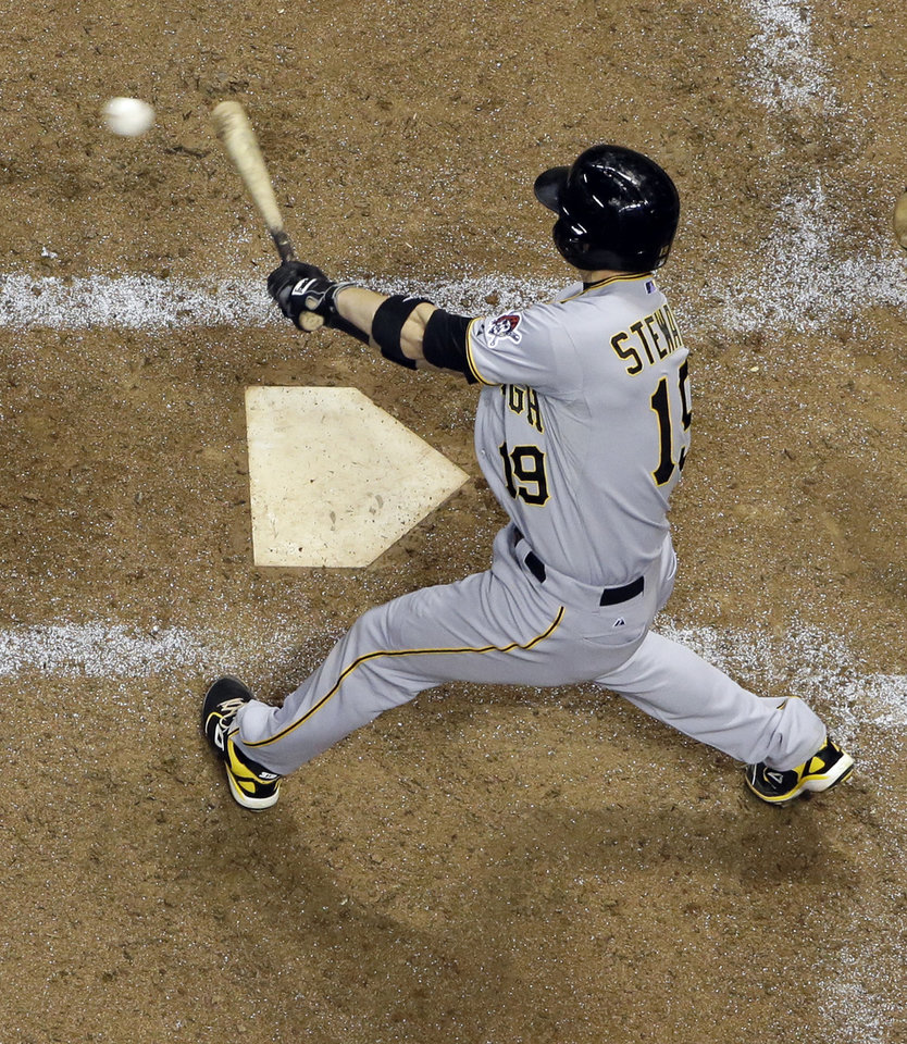 Photo - Pittsburgh Pirates' Chris Stewart hits an RBI single during the ninth inning of a baseball game against the Milwaukee Brewers Wednesday, May 14, 2014, in Milwaukee. (AP Photo/Morry Gash)
