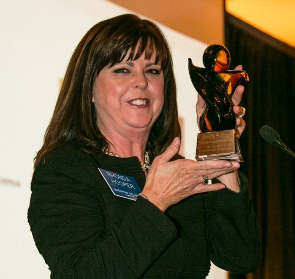 Rhonda Hooper shows her trophy at the dinner for  Leadership Oklahoma  at the Skirvin Hilton Hotel. The Distinguished Leader Award was given to Hooper and there was a live auction. The event followed the fall confluence. (Photo provided).