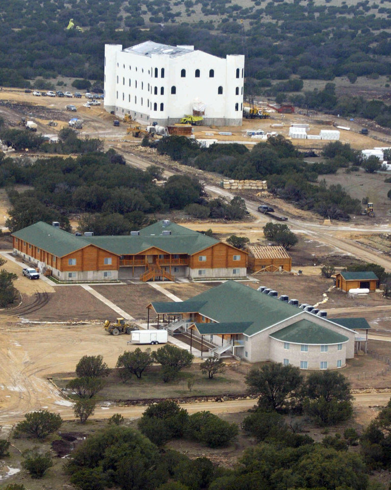 FILE - In this March 2, 2005 aerial file photo, the Fundamentalist Church of Jesus Christ of Latter Day Saints compound is shown under construction near Eldorado, Texas. Texas wants to take ownership of the polygamist ranch where the convicted sect leader Warren Jeffs and his followers sexually assaulted children. The Texas attorney general�s office filed a seizure warrant in rural Schleicher County on Wednesday, Nov. 28, 2012. (AP Photo/Donna McWilliam, File)