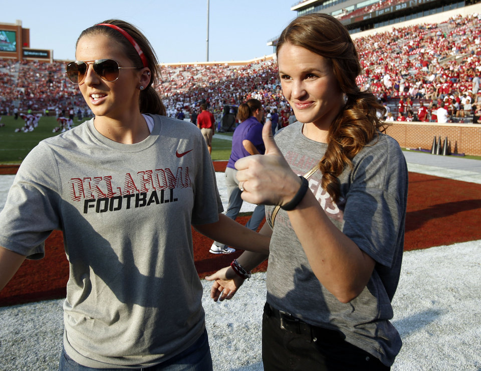 Mrs. Landry Jones (right) waits near the end zone before a college football game between the University of Oklahoma Sooners (OU) and the Kansas State University Wildcats (KSU) at Gaylord Family-Oklahoma Memorial Stadium, Saturday, September 22, 2012. At left is fellow basketball teammate Morgan Hook. Photo by Steve Sisney, The Oklahoman STEVE SISNEY - THE OKLAHOMAN
