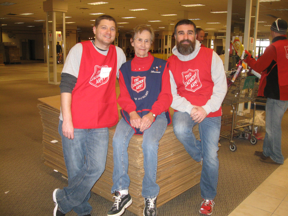 For the past four years, Cox Communications employees James Steele (left) and Mitchell Hayes have helped Sharron Ashton break down and store the mountains of boxes required for the Salvation Army's annual toy distribution to area needy families. PHOTO PROVIDED <strong></strong>