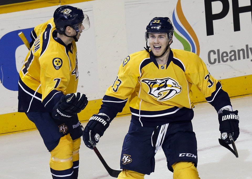 Photo - Nashville Predators center Colin Wilson (33) celebrates with David Legwand (11) after Wilson scored in overtime to give the Predators a 1-0 win over the San Jose Sharks in an NHL hockey game Tuesday, Feb. 12, 2013, in Nashville, Tenn. (AP Photo/Mark Humphrey)