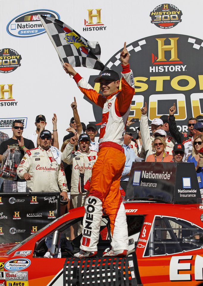 Photo - Kyle Larson poses for photos in Victory Lane after winning the NASCAR Nationwide series History 300 auto race at Charlotte Motor Speedway in Concord, N.C., Saturday, May 24, 2014. (AP Photo/Terry Renna)