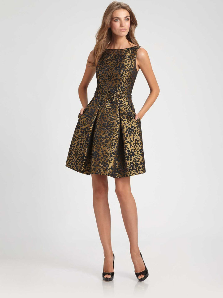 Lustrous brocade hints of old world Russian style in this modern-style Theia brocade dress with pleated skirt, $595; at select Saks Fifth Avenue stores and saks.com. (MCT)