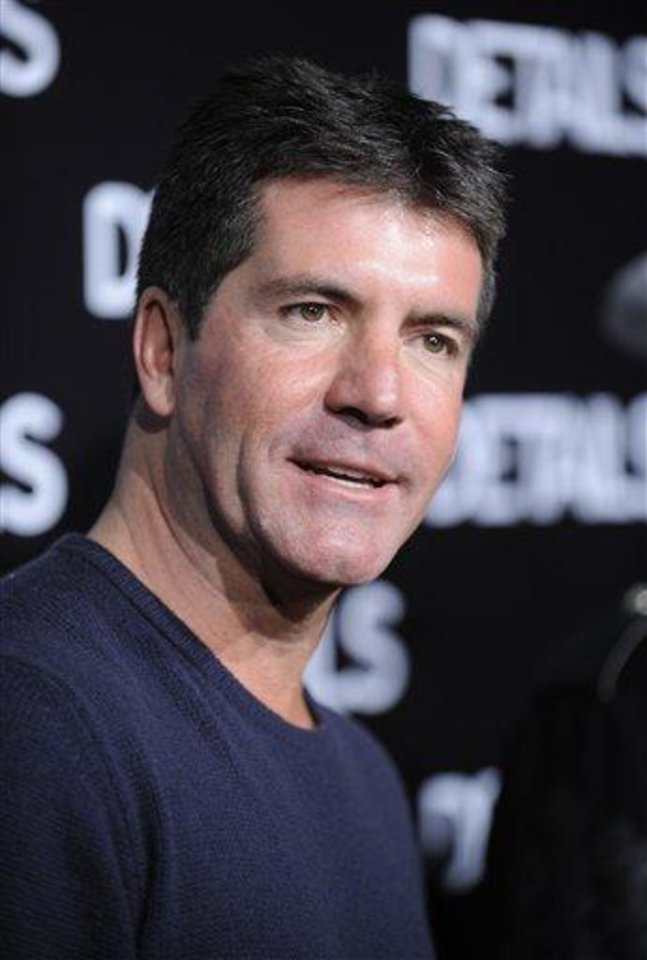 Simon Cowell - AP Photo