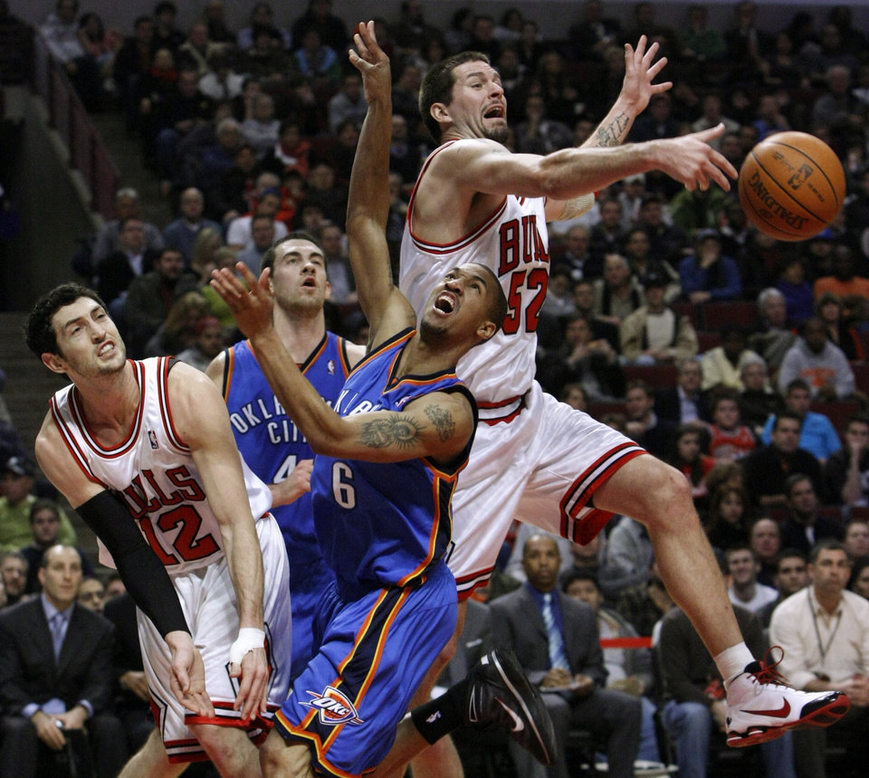 Chicago Bulls center Brad Miller, right, blocks the shot of Oklahoma City Thunder guard Eric Maynor (6), as Kirk Hinrich, left, and Nick Collison watch during the first half of an NBA basketball game Monday, Jan. 4, 2010, in Chicago. (AP Photo/Charles Rex Arbogast)