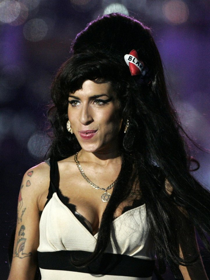 "Photo -   FILE - In this June 27, 2008 file photo, British singer-songwriter Amy Winehouse performs at the 46664 charity concert in honor of Nelson Mandela's 90th birthday in London. Winehouse had written all the songs that were to appear on her third album. She even picked out song titles. But music producer Salaam Remi said the singer was not rushing to release that new material. Only two of the tracks Winehouse wrote were recorded and appear on her compilation album, ""Lioness: Hidden Treasures."" It will be out on Dec. 5. (AP Photo/Lefteris Pitarakis, File)"