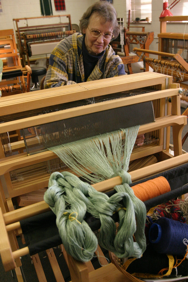 Pat Brainard threading a loom to weave fabric for a blouse Community Photo By: Bob Bozarth Submitted By: Sue, Guthrie