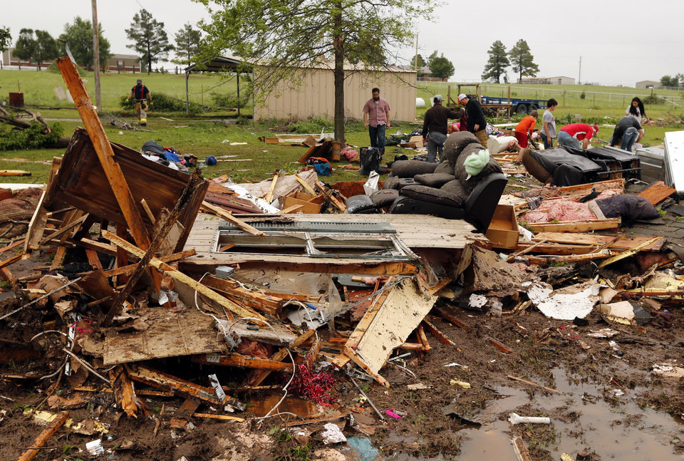 Photo - Friends and family of Kris and Christeen Allen look for mementos and valuables in the wreckage of their mobil home destroyed by storms on Friday, April 29, 2016 in Ninnekah, Okla.  Photo by Steve Sisney, The Oklahoman
