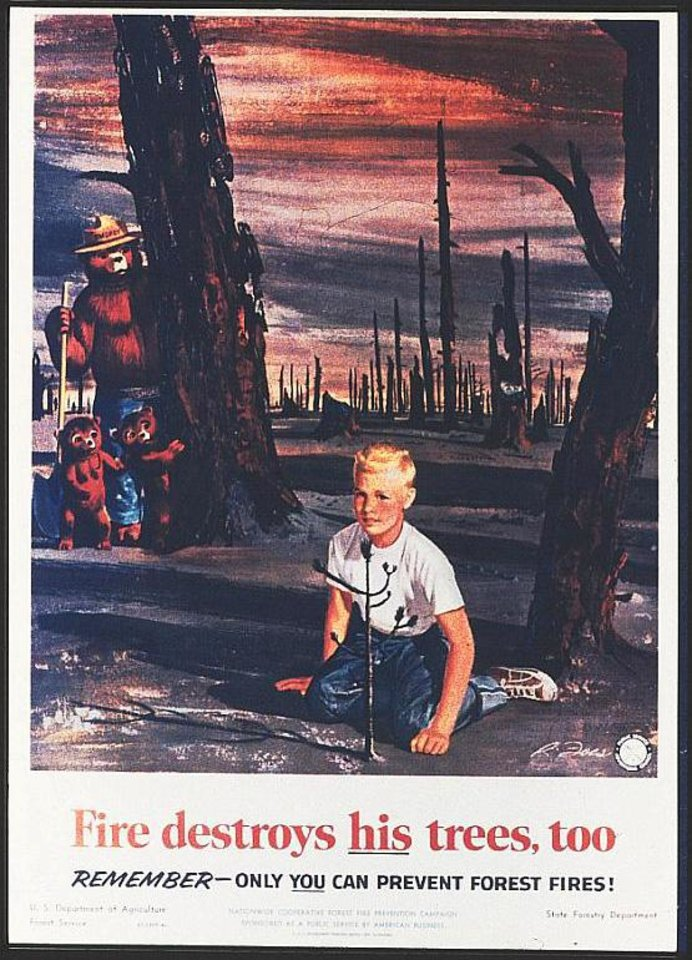 Photo - This image provided by the Ad Council  circa 1957 shows an early version of the Smokey Bear campaign.  Smokey Bear was created in 1944 because of fears that enemy shelling from Japan would cause forest fires while most U.S. firefighters were in battle overseas. When the war ended, Smokey stuck around _ and he is now at the center of the longest-running public service announcement campaign in U.S. history. Research shows he is known by 96 percent of American adults and ranks near Mickey Mouse and Santa Claus for name recognition. Smokey turns          seventy on Saturday Aug. 9, 2014. (AP Photo/Ad Council)