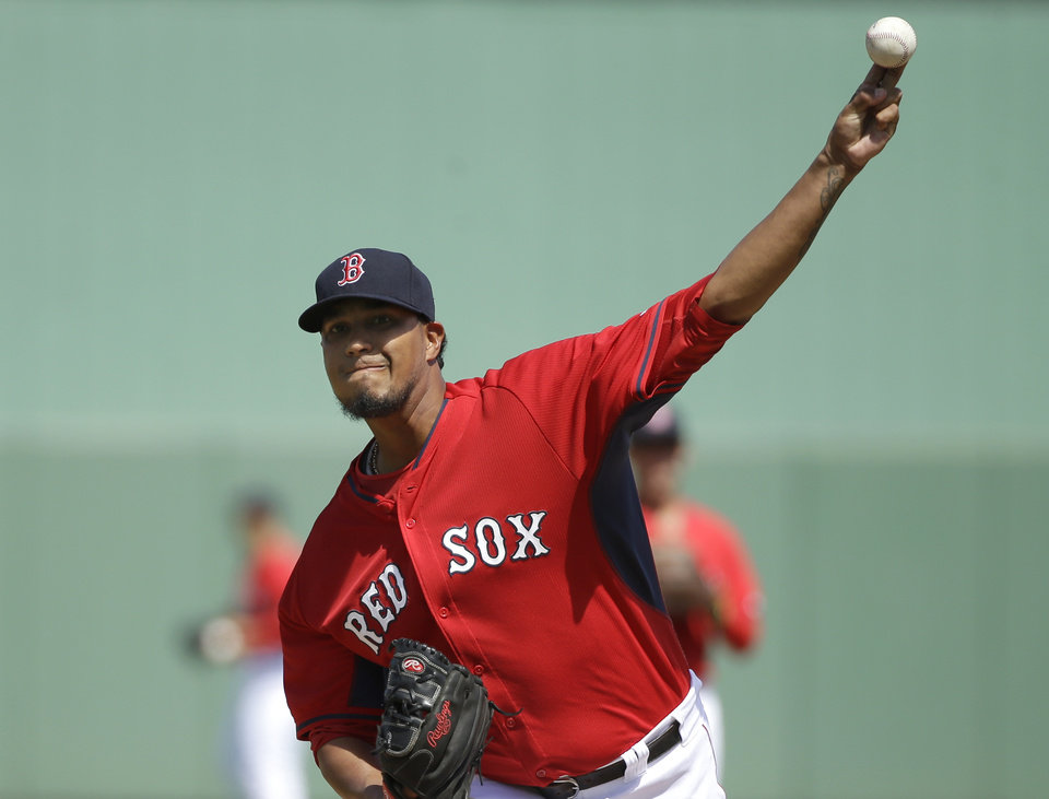 Photo - Boston Red Sox's Felix Doubront delivers a warm-up pitch during the first inning of an exhibition baseball game against the Atlanta Braves, Friday, March 7, 2014, in Fort, Myers, Fla. (AP Photo/Steven Senne)