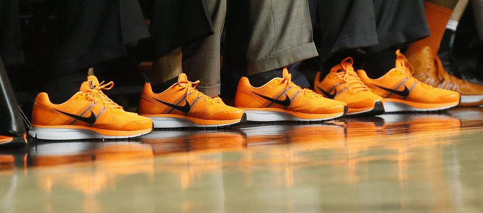 Photo - The OSU coaching staff wears matching orange shoes during an NCAA men's basketball game between Oklahoma State University (OSU) and West Virginia at Gallagher-Iba Arena in Stillwater, Okla., Saturday, Jan. 26, 2013. Photo by Nate Billings, The Oklahoman