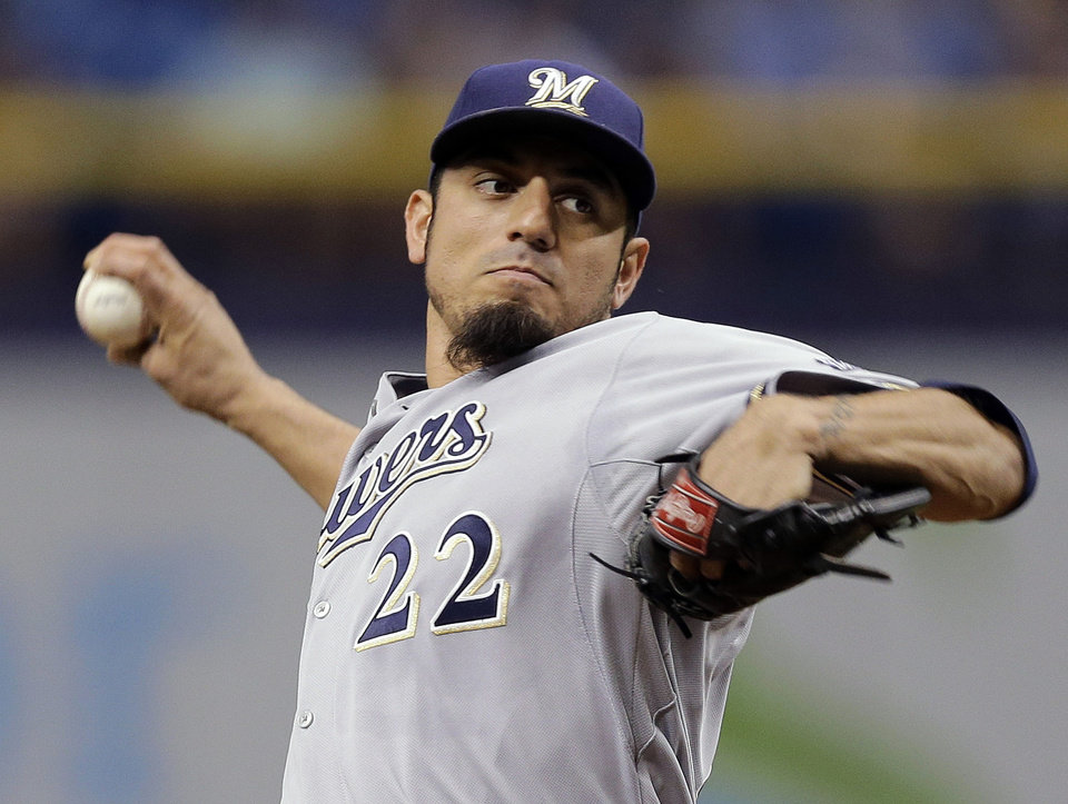 Photo - Milwaukee Brewers starting pitcher Matt Garza delivers to the Tampa Bay Rays during the first inning of a baseball game Tuesday, July 29, 2014, in St. Petersburg, Fla. (AP Photo/Chris O'Meara)