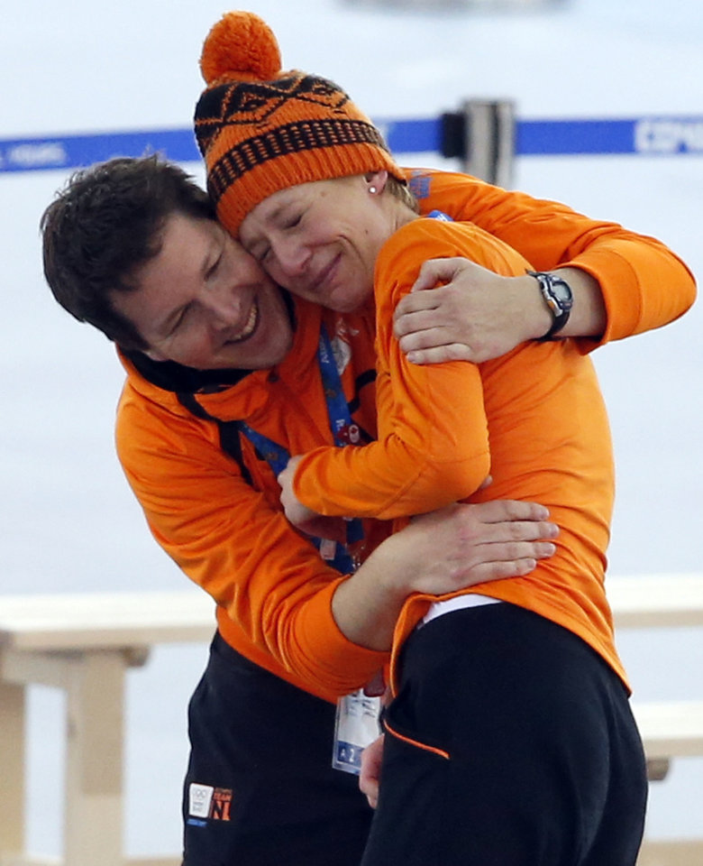 Photo - A coach hugs an emotional Carien Kleibeuker of the Netherlands after it became clear she won a bronze in the women's 5,000-meter speedskating race at the Adler Arena Skating Center during the 2014 Winter Olympics in Sochi, Russia, Wednesday, Feb. 19, 2014. (AP Photo/Pavel Golovkin)