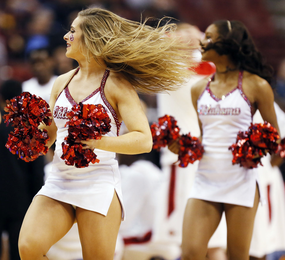 Photo - The OU pom squad dances during a game between the University of Oklahoma and San Diego State in the second round of the NCAA men's college basketball tournament at the Wells Fargo Center in Philadelphia, Friday, March 22, 2013. San Diego State beat OU, 70-55. Photo by Nate Billings, The Oklahoman