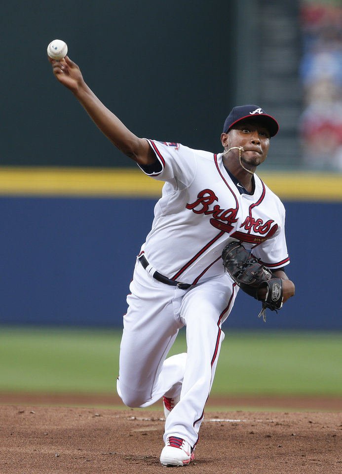 Photo - Atlanta Braves starting pitcher Julio Teheran (49) works in the first inning of a baseball game against theMiami Marlins  in Atlanta, Monday, July 21, 2014. (AP Photo/John Bazemore)