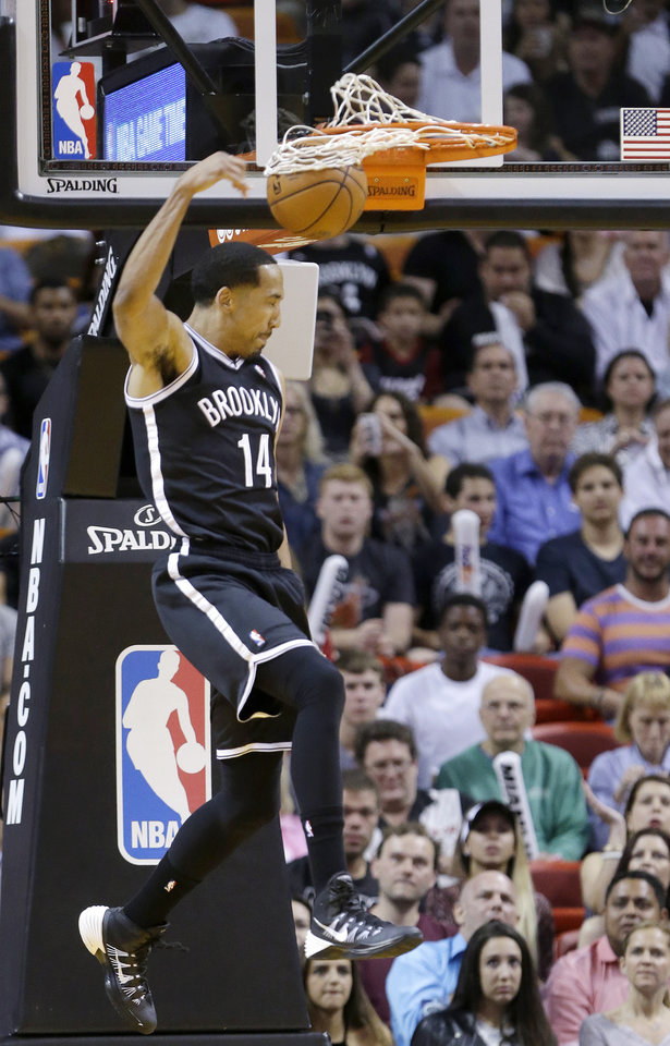Photo - Brooklyn Nets guard Shaun Livingston dunks the ball during the first half of an NBA basketball game against the Miami Heat, Tuesday, April 8, 2014 in Miami. (AP Photo/Wilfredo Lee)