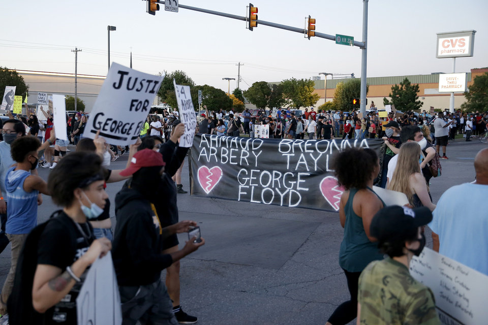 Photo - Protesters march around the intersection of 23rd and Classen in Oklahoma City, Saturday, May 30, 2020. The protest was in response to the death of George Floyd. [Bryan Terry/The Oklahoman]