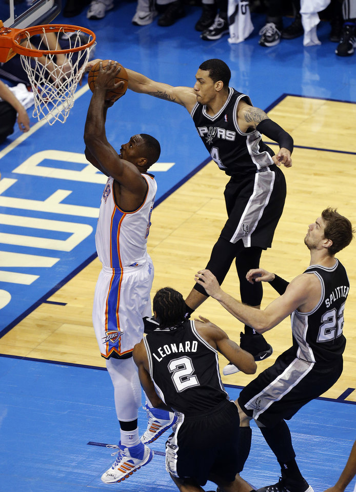Photo - Oklahoma City's Serge Ibaka (9) goes up for a basket as San Antonio's Danny Green (4), Kawhi Leonard (2) and Tiago Splitter (22) defend during Game 4 of the Western Conference Finals in the NBA playoffs between the Oklahoma City Thunder and the San Antonio Spurs at Chesapeake Energy Arena in Oklahoma City, Tuesday, May 27, 2014. Photo by Bryan Terry, The Oklahoman