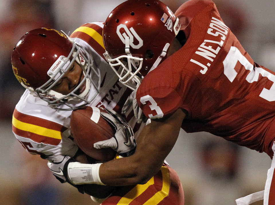 Photo - Oklahoma's Jonathan Nelson 93) stops Iowa State's Shontrelle Johnson (25) during the second half of the college football game between the University of Oklahoma Sooners (OU) and the Iowa State Cyclones (ISU) at the Gaylord Family-Oklahoma Memorial Stadium on Saturday, Oct. 16, 2010, in Norman, Okla.  Photo by Chris Landsberger, The Oklahoman