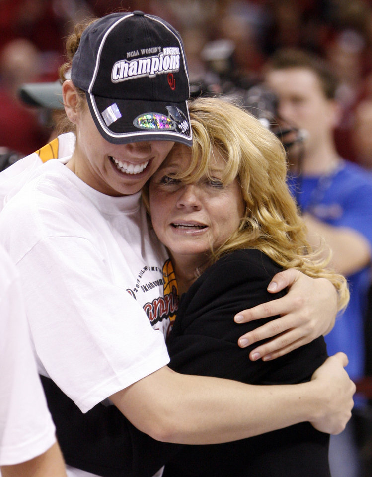 Photo - Sooner head coach Sherri Coale hugs Carlee Roethlisberger after her team's 74-68 win as the University of Oklahoma (OU) defeats Purdue in the NCAA women's basketball regional tournament finals at the Ford Center in Oklahoma City, Okla., on Tuesday, March 31, 2009.  Photo by Steve Sisney, The Oklahoman
