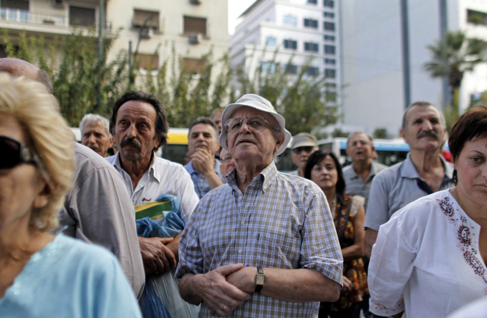 Pensioners attend an anti-austerity protest in front of the EU headquarters in Athens on Monday, Oct. 8, 2012. The 17 eurozone ministers will look Monday at Greece's budget proposals. They will hear from the troika — the European Commission, the European Central Bank and the International Monetary Fund — about its negotiations with the Greek government. No final troika report will be submitted, so no decision on a new payout of aid will be made.(AP Photo)