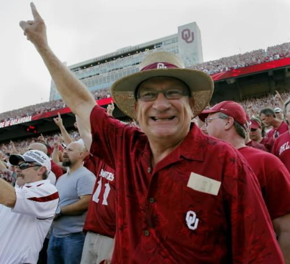 Photo - Gary Parks, Moore, raises his hand before the college football game between the University of Oklahoma Sooners ( OU) and the Tulsa University Hurricanes (TU) at the Gaylord Family-Memorial Stadium on Saturday, Sept. 3, 2011, in Norman, Okla. Photo by Steve Sisney, The Oklahoman ORG XMIT: KOD