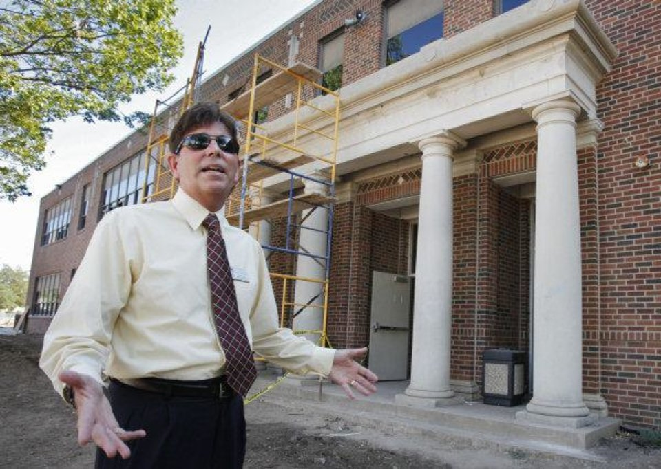 Norman School District Assistant Superintendent Roger Brown describes renovations going on at Longfellow Middle School. A blackboard with writings dating to 1935 was found inside a wall at the school. PHOTO BY STEVE SISNEY, THE OKLAHOMAN <strong>STEVE SISNEY - THE OKLAHOMAN</strong>