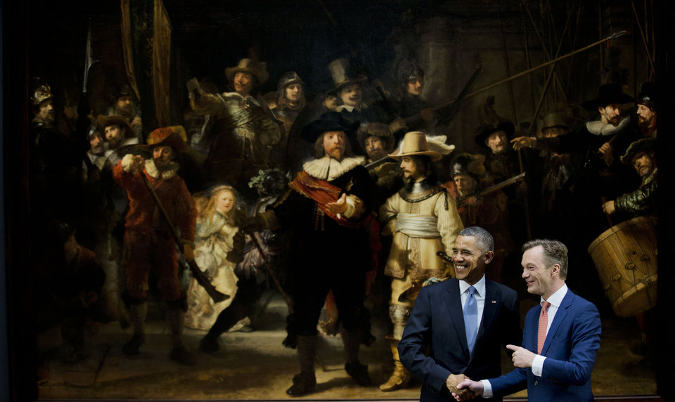Photo - U.S. President Barack Obama, left, and museum director Wim Pijbes pose in front of  Dutch master Rembrandt's The Night Watch painting during a visit to the Rijksmuseum in Amsterdam, Netherlands, Monday, March 24, 2014. Obama will attend the two-day Nuclear Security Summit in The Hague. (AP Photo/Jerry Lampen, Pool)