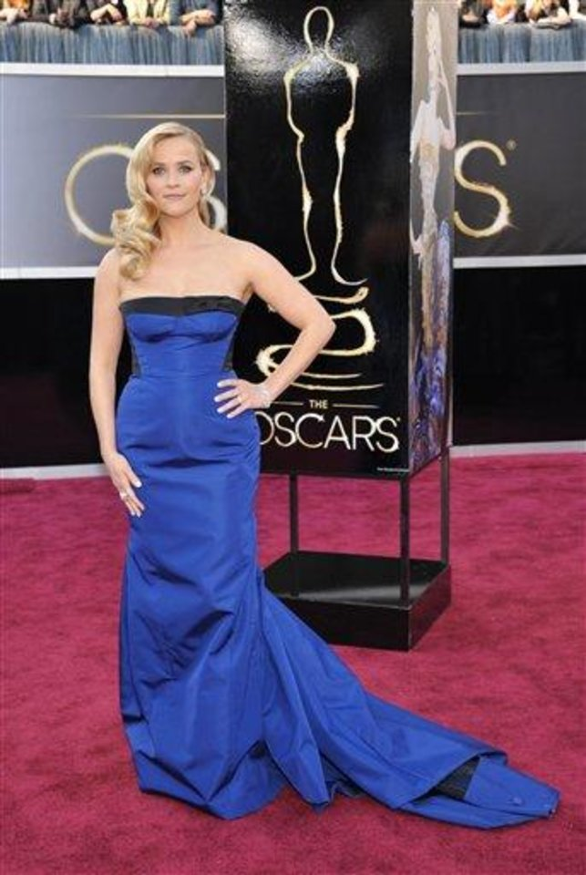 Photo - Reese Witherspoon arrives at the 85th Academy Awards at the Dolby Theatre on Sunday Feb. 24, 2013, in Los Angeles. (Photo by John Shearer/Invision/AP)
