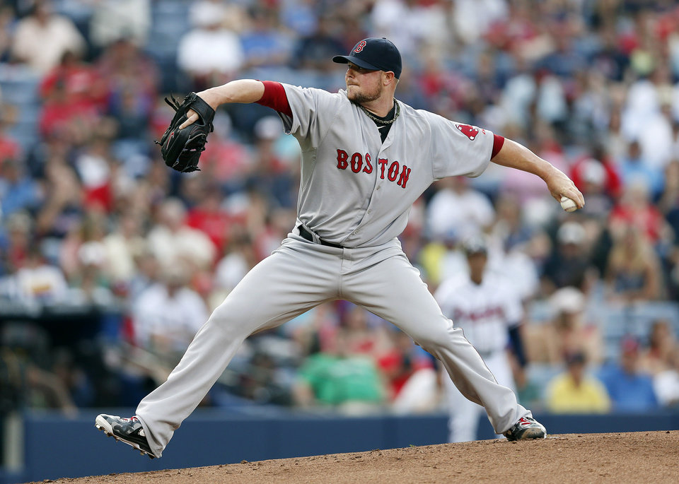 Photo - Boston Red Sox starting pitcher Jon Lester works in the first inning of a baseball game against Atlanta Braves on Tuesday, May 27, 2014, in Atlanta. (AP Photo/John Bazemore)